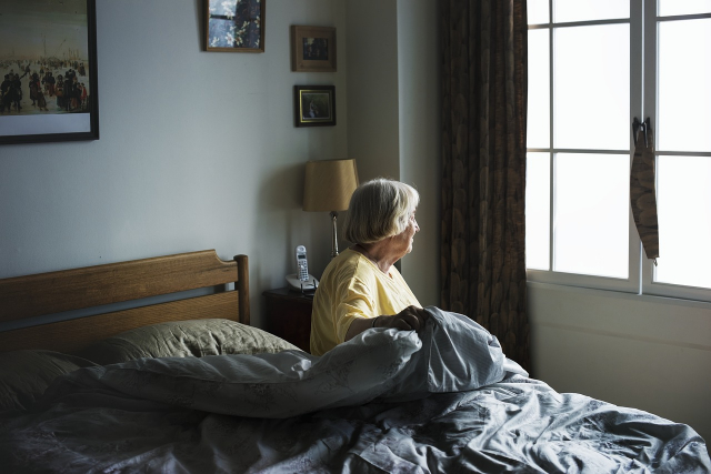 Elderly Person Sick in Bed