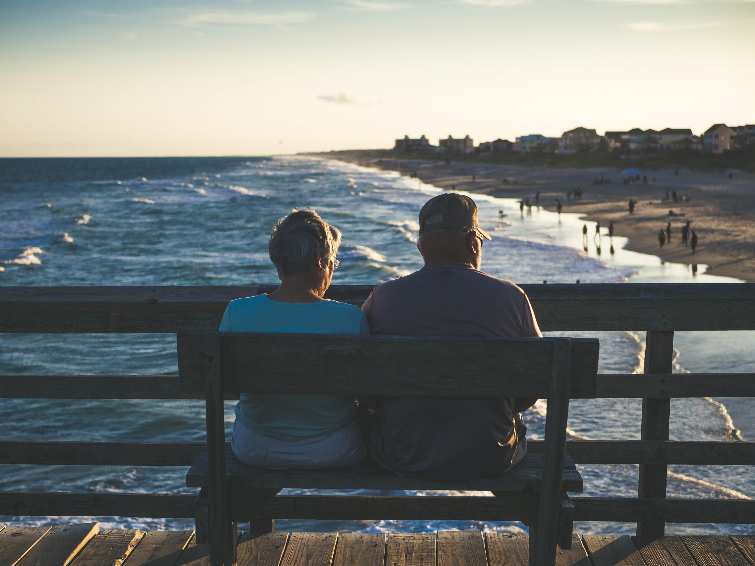 Husband and Wife Sitting on Bench