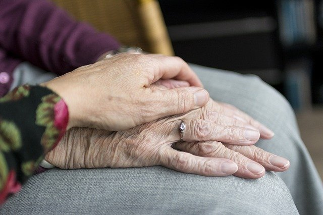 Elderly Friends Holding Hands