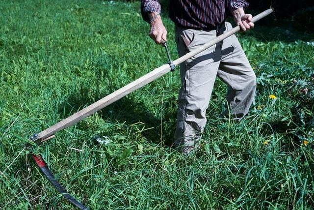 Elderly Man Tending His Yard